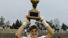 Garden City's Brian Badgett hoists the championship trophy