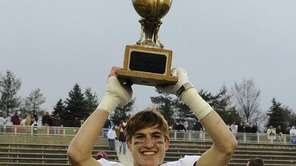 Garden City's Brian Badgett hoists the championship trophy