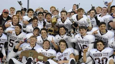 Garden City celebrates after their 29-16 win over
