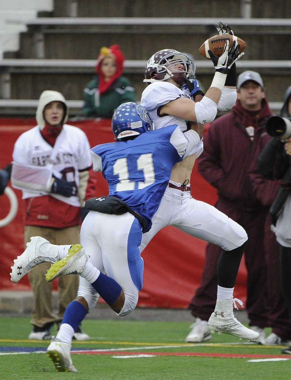 Garden City's Ed Blatz makes the catch defended
