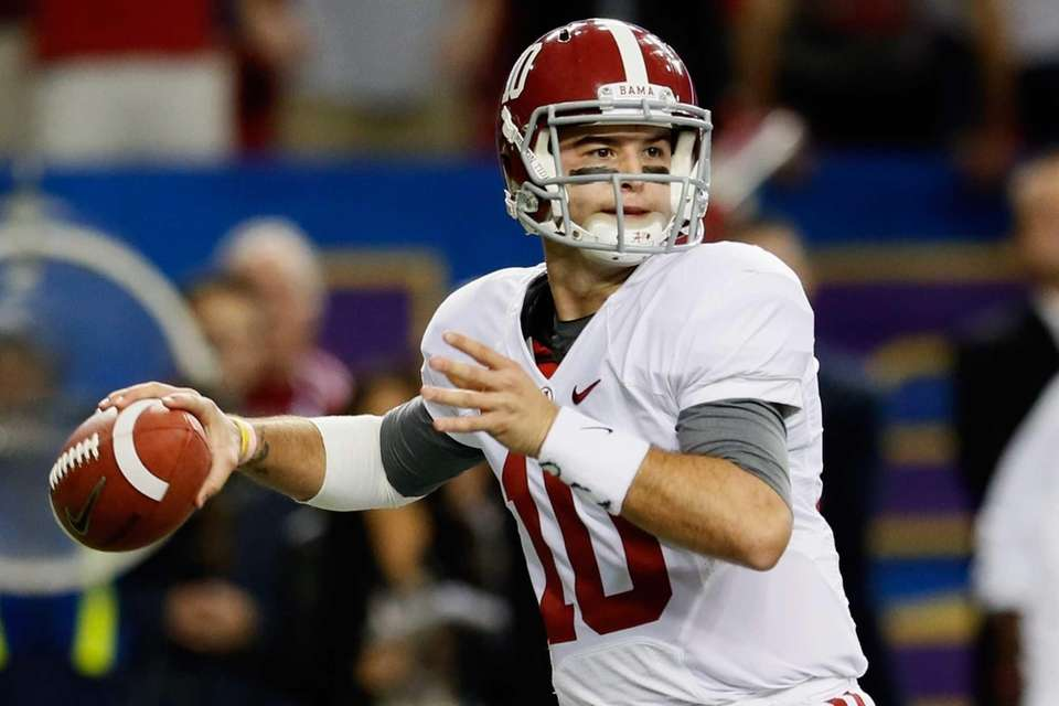 Alabama's AJ McCarron drops back to pass against