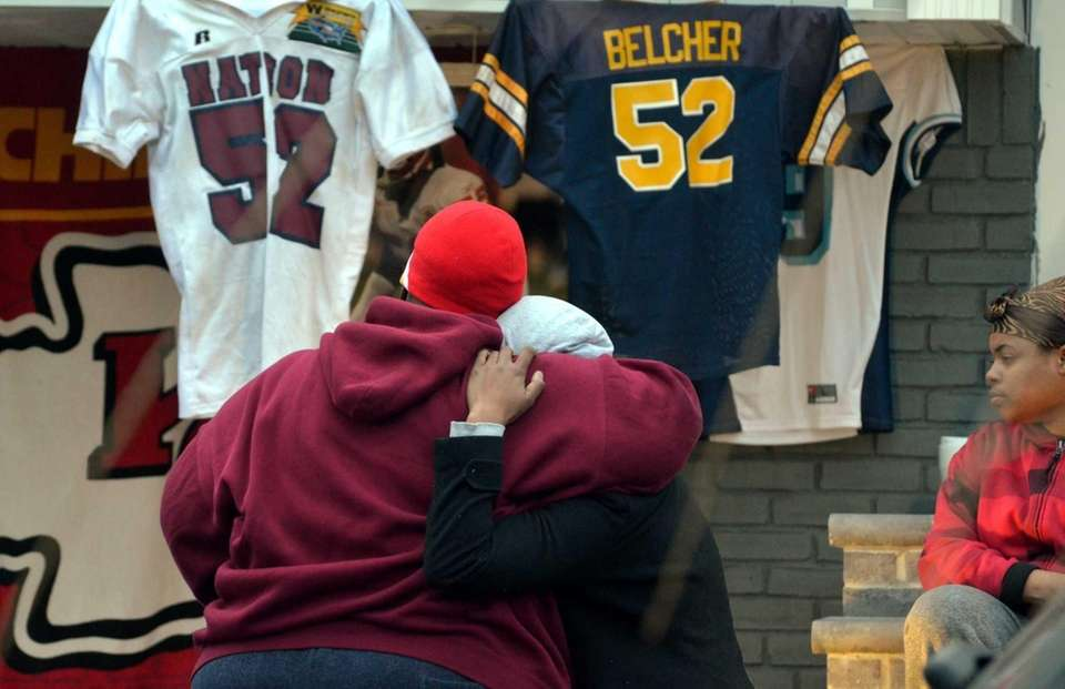 Charmaine Miles, left, Jovan Belcher's sister, is consoled