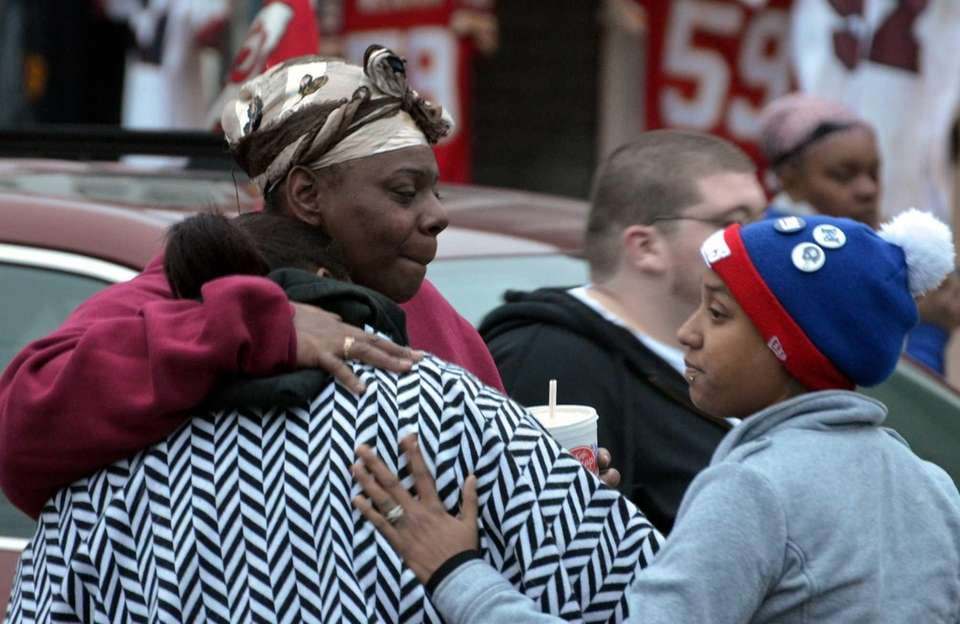 Charmaine Miles, left, Jovan Belcher's sister, embraces friends