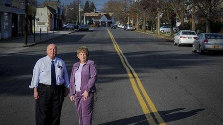 Joe Margolin, right, and Carol Crupi stand on