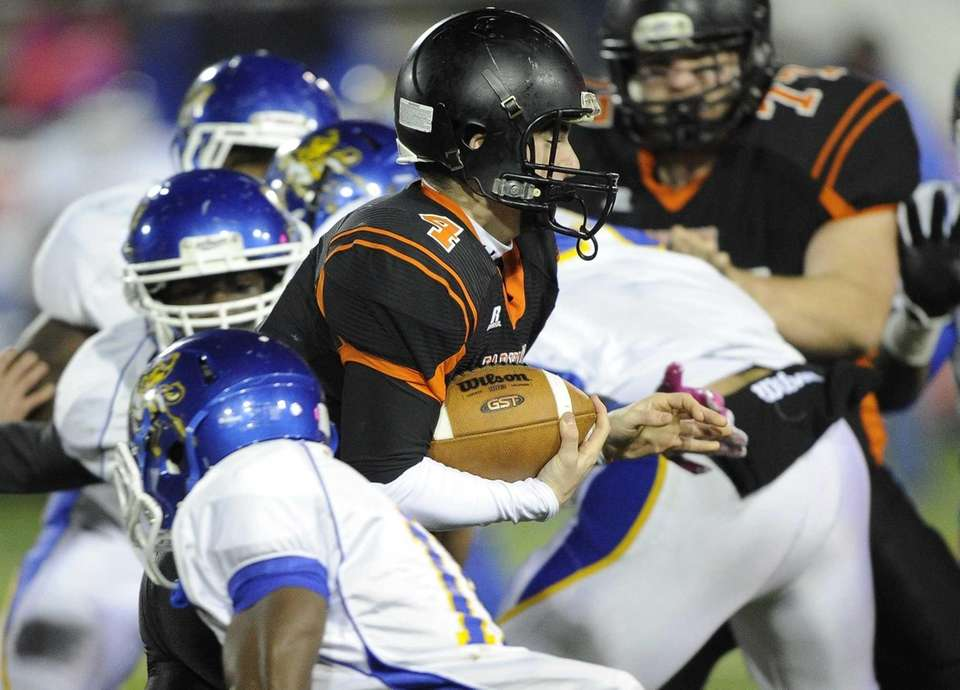 Babylon quarterback Nick Santorelli keeps the ball and