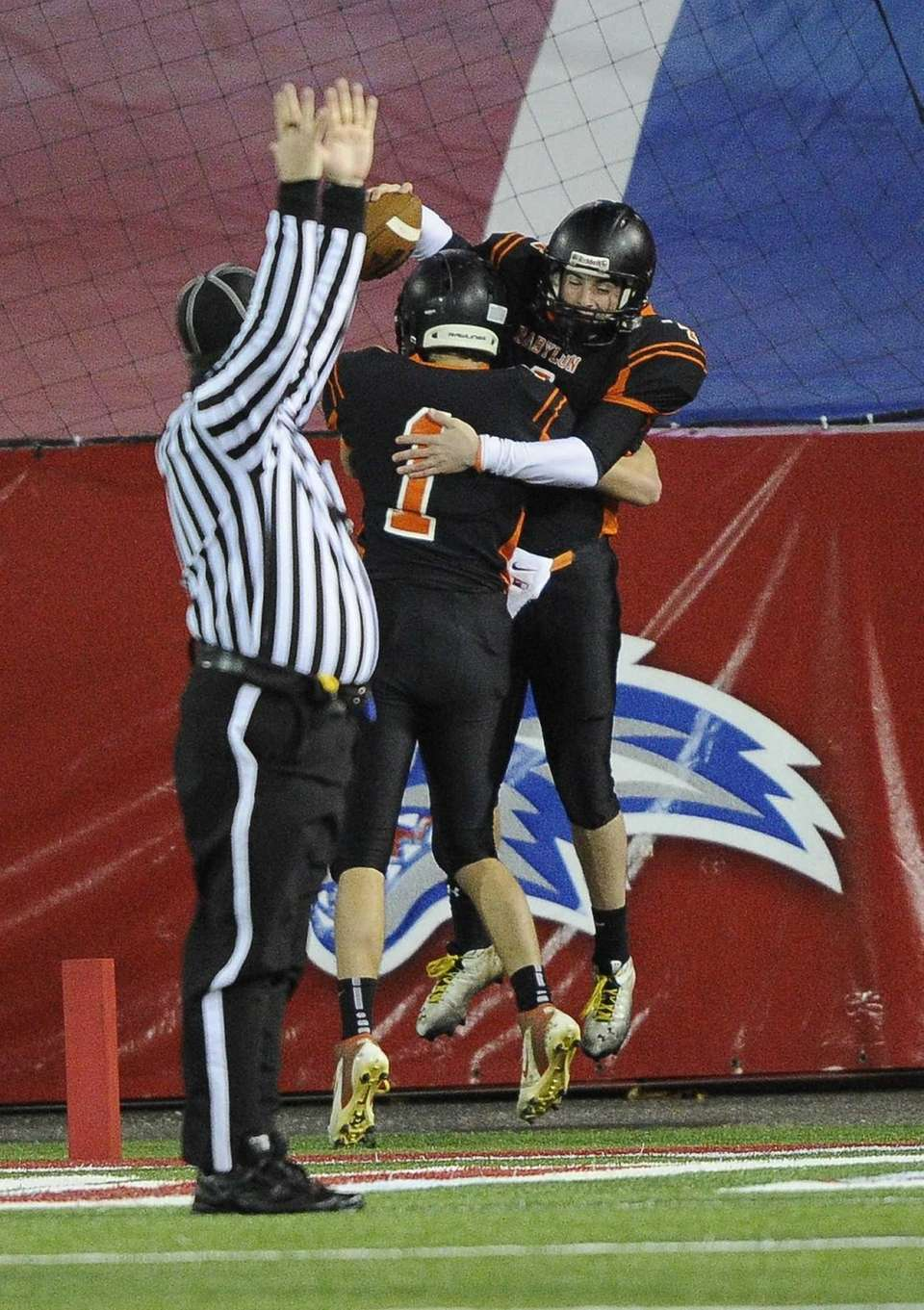 Babylon quarterback Nick Santorelli celebrates his touchdown with