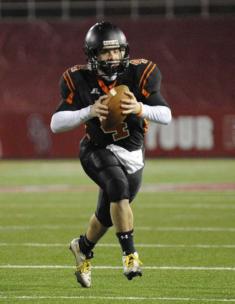 Babylon quarterback Nick Santorelli runs the ball against