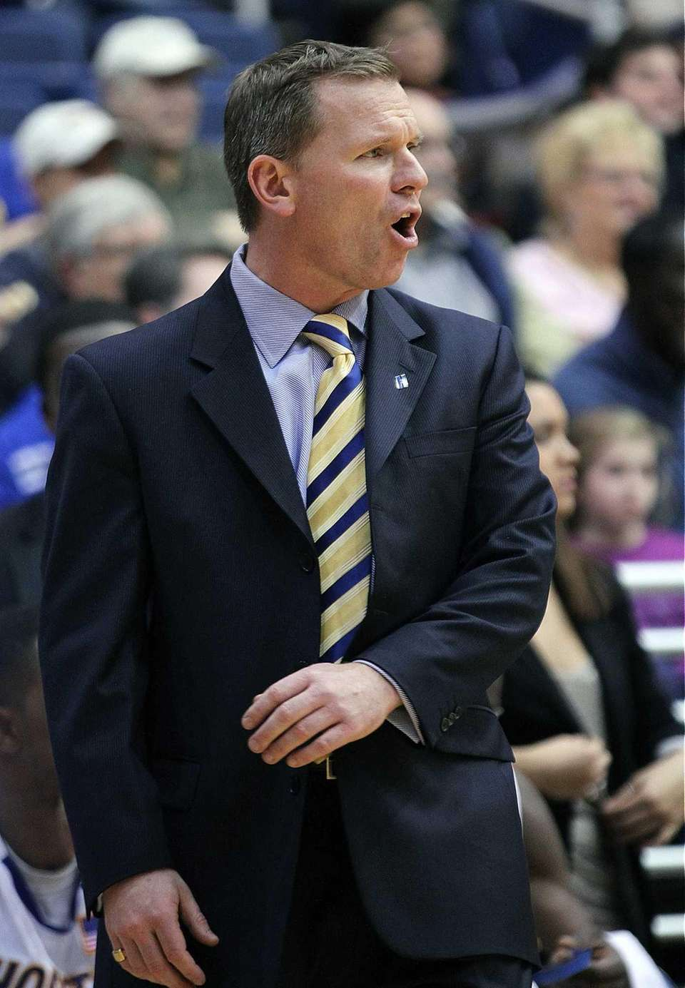 Hofstra head coach Mo Cassara talks to his