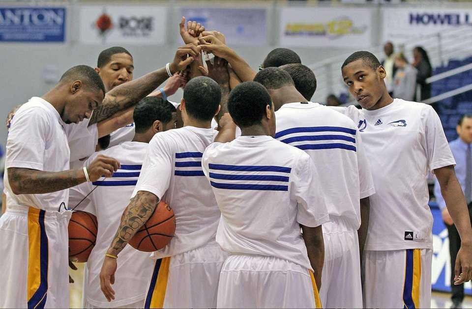 Hofstra players gather on the court prior to