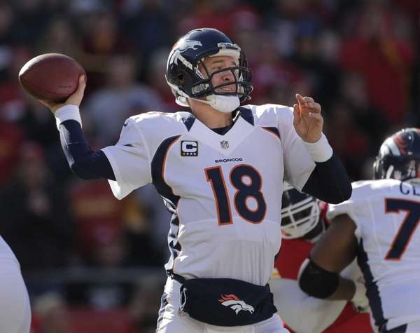 Denver Broncos quarterback Peyton Manning passes during the
