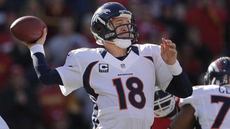Denver Broncos quarterback Peyton Manning passes during the