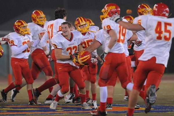 Chaminade players celebrate after their 17-16 win over