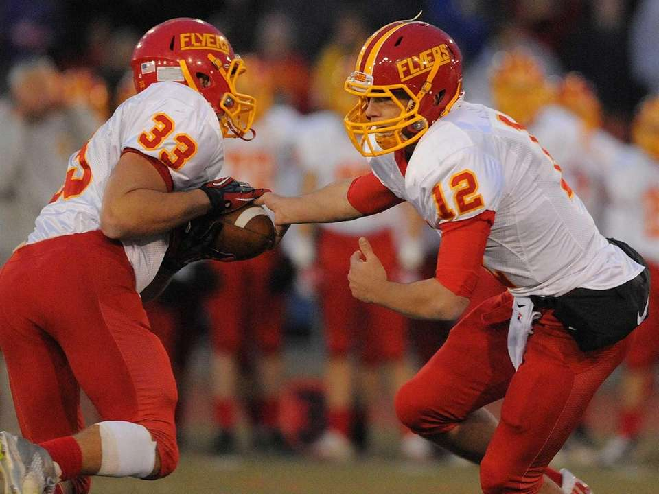 Chaminade quarterback Sean Cerrone, right, hands off to
