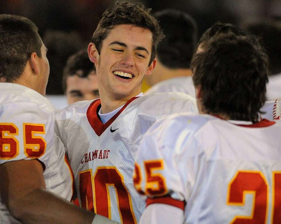 Chaminade kicker Zane Wasp, center, celebrates with teammates