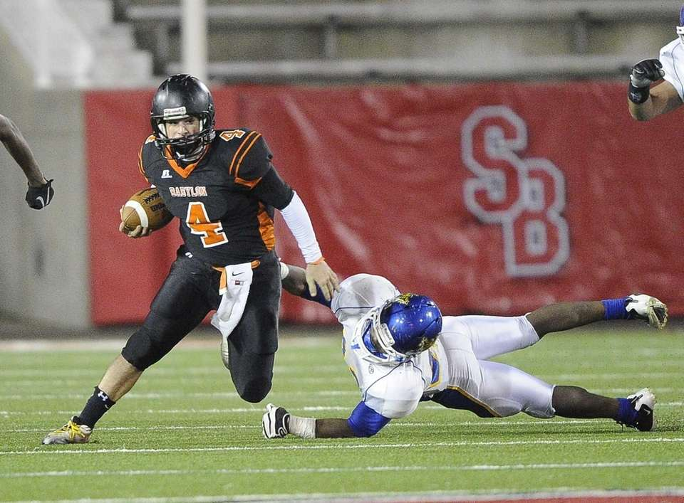 Babylon quarterback Nick Santorelli escapes a tackle by