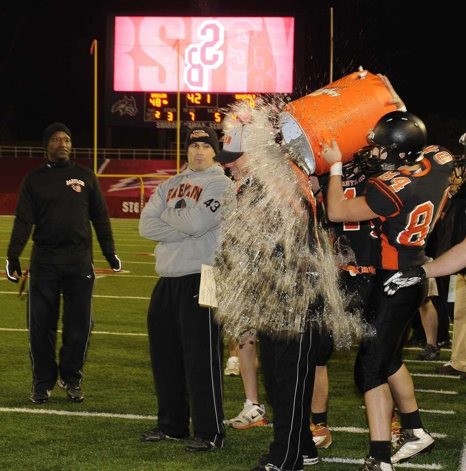 Babylon head coach Rick Punzone gets a celebratory