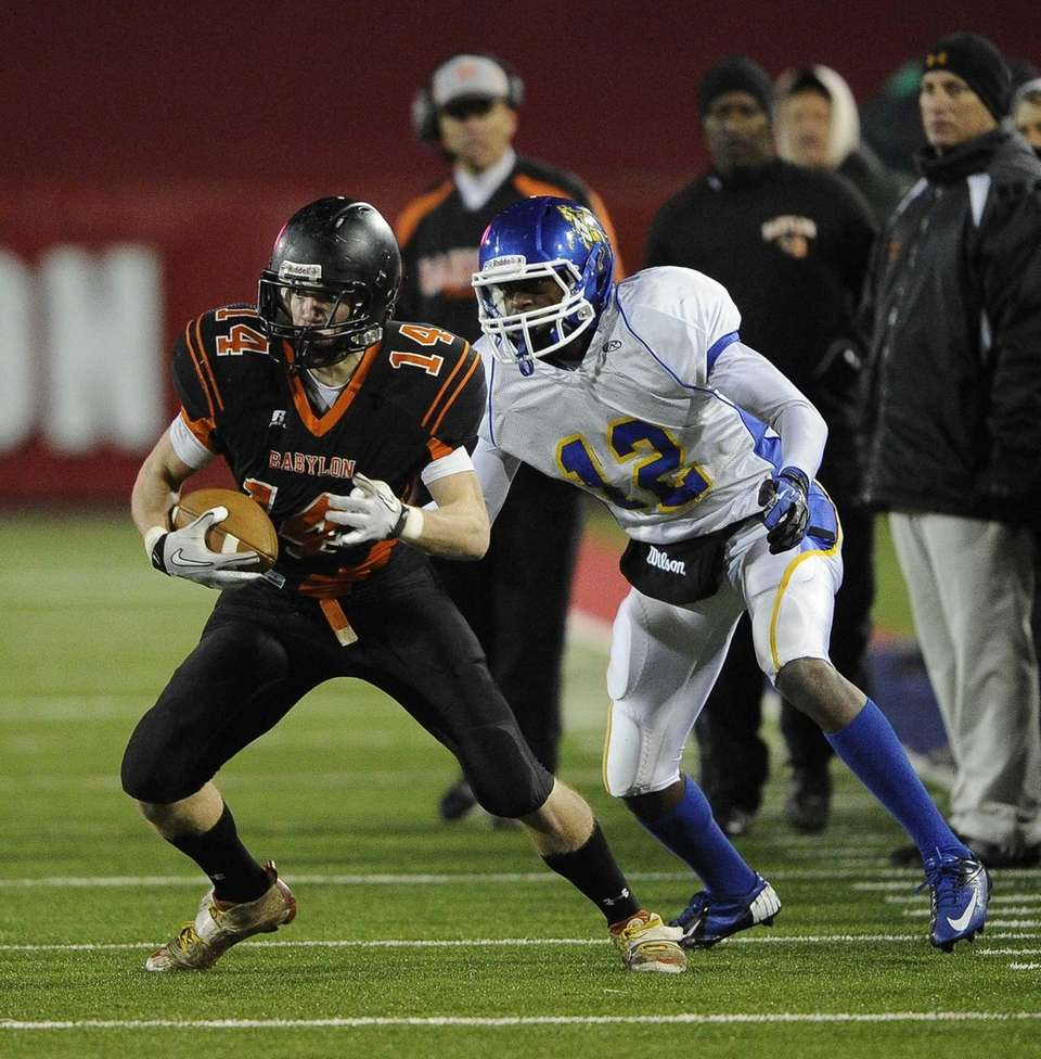Babylon's Jake Carlock rushes against Roosevelt in the