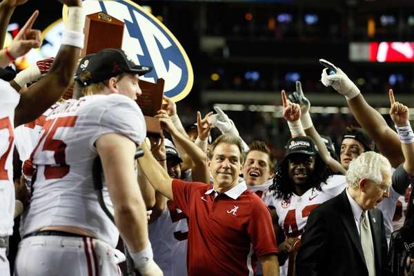 Alabama head coach Nick Saban poses with the