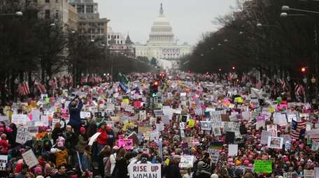 Protesters walk during the Women's March on Washington,