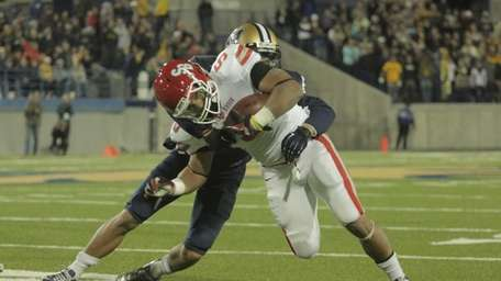 Stony Brook running back Miguel Maysonet carries the