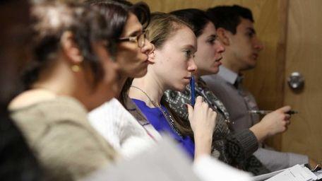Counselors take notes as Steven Crimando, a disaster