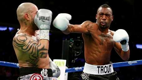 Austin Trout, right, throws a punch against Miguel