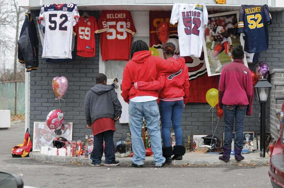 Relatives and friends pay respects at the West
