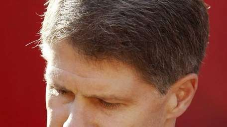 Kansas City Chiefs owner Clark Hunt pauses while