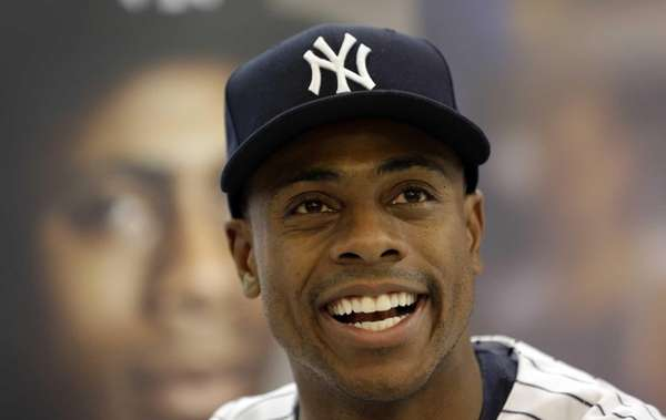 Curtis Granderson smiles during an autograph sessions for