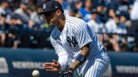 The Yankees' Gleyber Torres fielding a hit by