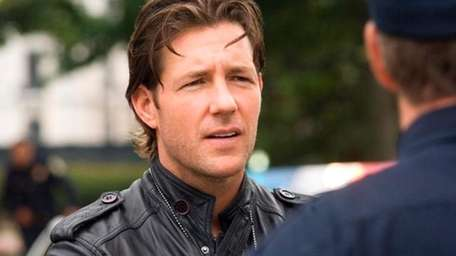 Director Ed Burns on the set of The