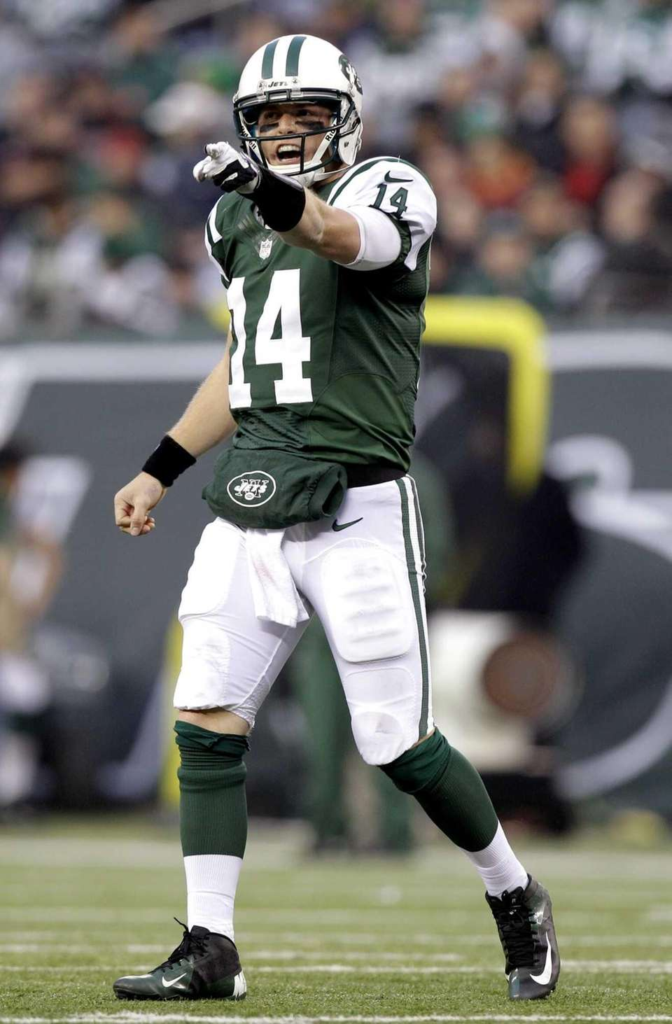 Jets quarterback Greg McElroy gestures during the second