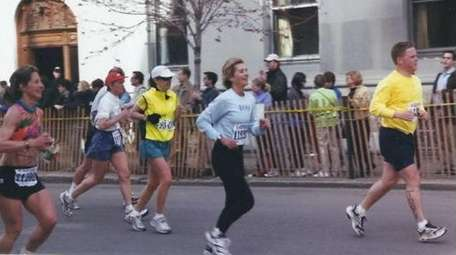 Barb Murphy nears the finish line of the