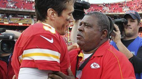Kansas City Chiefs coach Romeo Crennel, right, talks