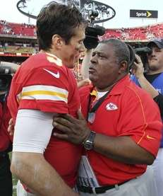 Kansas City Chiefs coach Romeo Crennel, right, talks