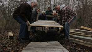 Volunteers work in Heckscher State Park to repair