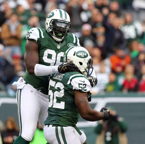 Jets defenders David Harris and Muhammad Wilkerson celebrate
