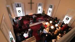 Worshipers participate in a Christmas service at the
