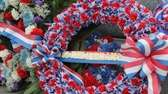 Many red, white and blue wreathes were placed