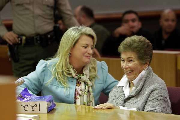 Attorney Alison Triessl, left, reacts with Lois Goodman