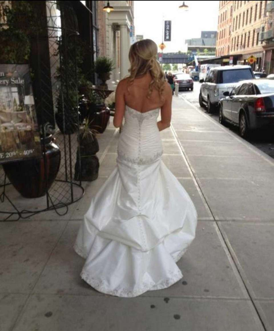 Bride Samantha Shea wears the white beaded wedding