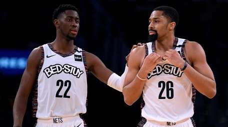 Spencer Dinwiddie of the Nets, right, reacts to