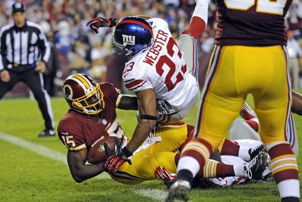 Washington Redskins wide receiver Josh Morgan falls into