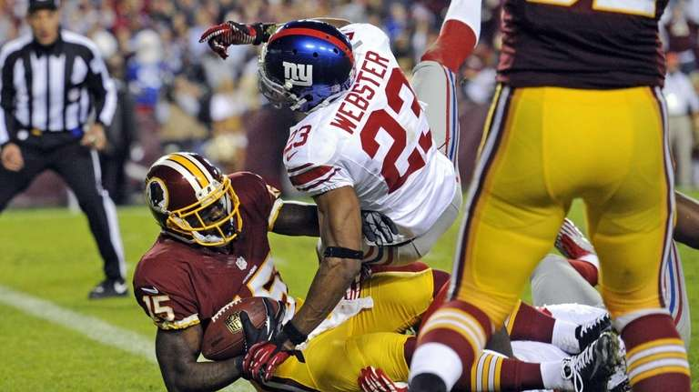Washington Redskins wide receiver Josh Morgan falls into