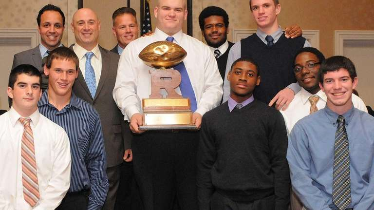 Players and coaches from Babylon's varsity football team