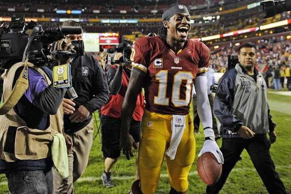 Washington Redskins quarterback Robert Griffin III celebrates as