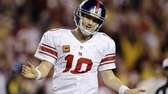 New York Giants quarterback Eli Manning reacts to