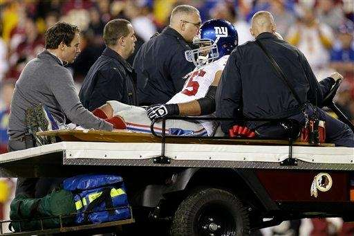 New York Giants tackle Sean Locklear is wheeled
