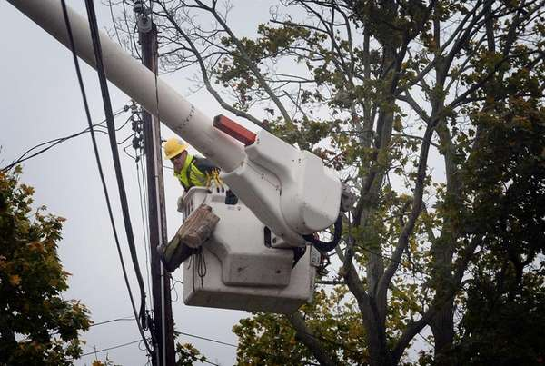 A LIPA electrical contractor works to restore power