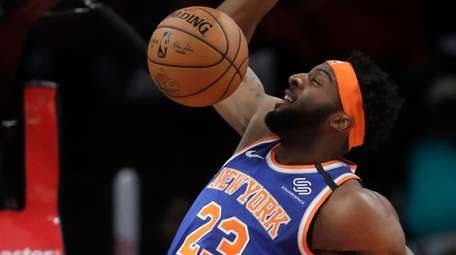Knicks center Mitchell Robinson scores during the first